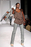 Models wearing Baby Phat work the runway at the Funkshion Fashion Week show Wednesday, March 22, 2006 in Miami, Florida.