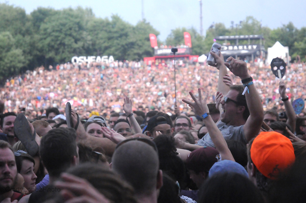 Crowd surfing in between acts around the main stages site during Osheaga at Parc Jean Drapeau. August 2014. (Cult MTL)