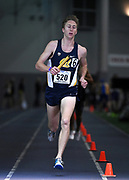 Feb 24, 2017; Seattle, WA, USA; Garrett Corcoran runs the anchor leg on the California distance medley relay that won in 9:34.11 during the MPSF Indoor Championships at the Dempsey Indoor.