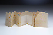 Folded and cut piano paper was used for this accordion style books by Anna Lambrini Moisiadis.