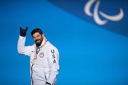 March 12, 2018 - Pyeongchang, South Korea - Silver medalist Keith Gabel of the US celebrates during a medal ceremony for Men's Snowboard Cross Monday, March 12, 2018 at the Medals Plaza for the 2018 Pyeongchang Winter Paralympic Games. Photo by Mark Reis (Credit Image: © Mark Reis via ZUMA Wire)
