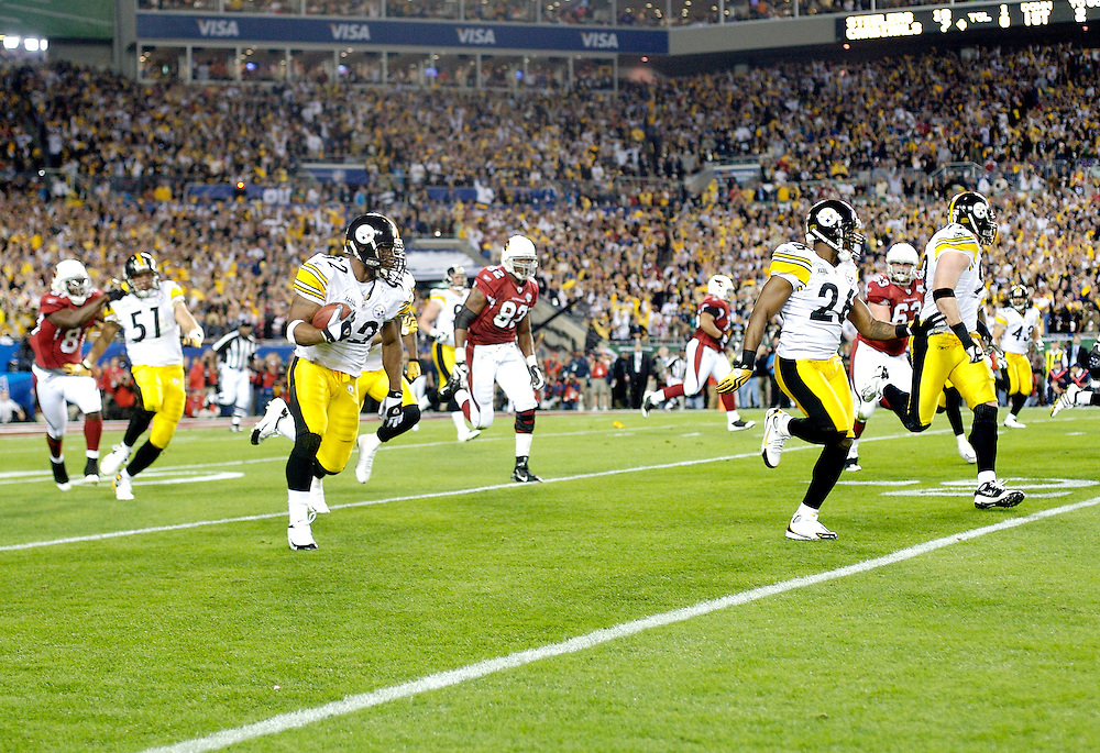 TAMPA, FL - FEBRUARY 01: Linebacker James Harrison #92 of the Pittsburgh Steelers runs back an interception for a touchdown in the 2nd quarter drops against the Arizona Cardinals during Super Bowl XLIII on February 1, 2009 at Raymond James Stadium in Tampa, Florida. The Steelers defeated the Cardinals 27 to 23. (Photo by Rob Tringali) *** Local Caption *** James Harrison