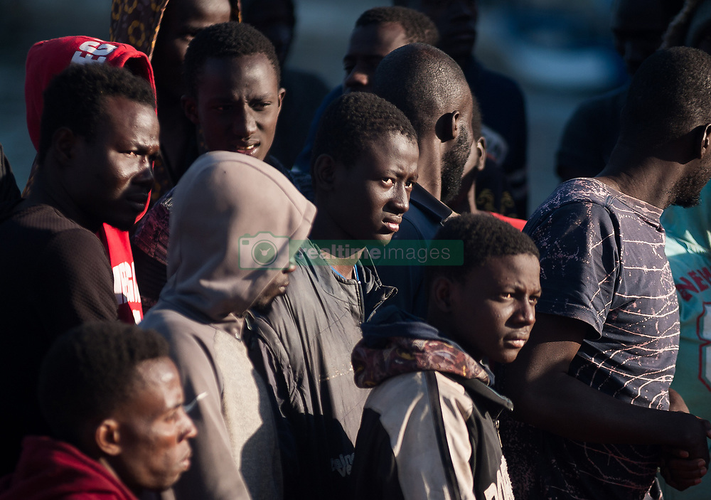 May 23, 2019 - Malaga, Spain - Migrants are seen looking on as they stand on a rescue boat after their arrival at the Port of Malaga..Spain's Maritime Rescue service has rescued 58 migrants aboard a dinghy crossing the Alboran Sea and brought them to Malaga harbour, where they were assisted by the Spanish Red Cross. (Credit Image: © Jesus Merida/SOPA Images via ZUMA Wire)