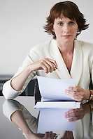 Business woman working at conference table portrait