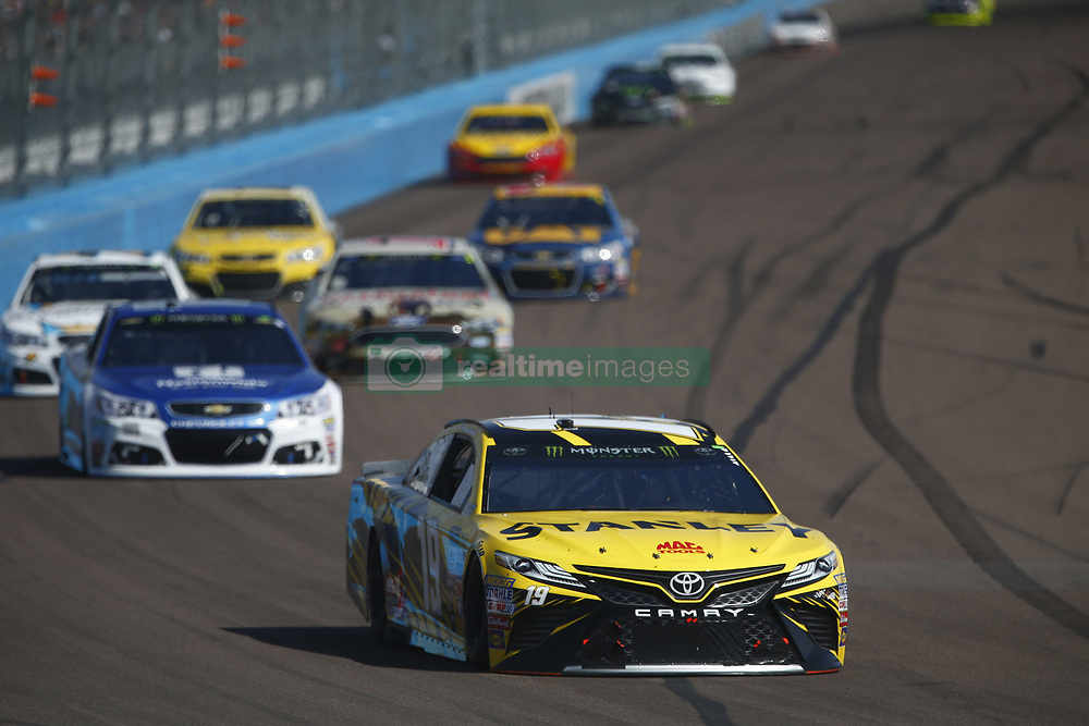 November 12, 2017 - Avondale, Arizona, United States of America - November 12, 2017 - Avondale, Arizona, USA: Daniel Suarez (19) battles for position during the Can-Am 500(k) at Phoenix Raceway in Avondale, Arizona. (Credit Image: © Justin R. Noe Asp Inc/ASP via ZUMA Wire)