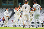Wicket! Kent celebrate taking the wicket of Sam Curran of Surrey during the Specsavers County Champ Div 1 match between Surrey County Cricket Club and Kent County Cricket Club at the Kia Oval, Kennington, United Kingdom on 10 July 2019.