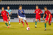 Thomas Dickson-Peters (Norwich City) chases Rafael Brito during the U17 European Championships match between Portugal and Scotland at Simple Digital Arena, Paisley, Scotland on 20 March 2019.