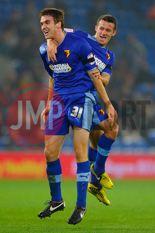 Watford Defender Tommie Hoban (IRL) celebrates with Midfielder Jonathan Hogg (ENG) after scoring surprise first goal against the run of play during the first half of the match - Photo mandatory by-line: Rogan Thomson/JMP - Tel: Mobile: 07966 386802 23/10/2012 - SPORT - FOOTBALL - Cardiff City Stadium - Cardiff. Cardiff City v Watford - Football League Championship