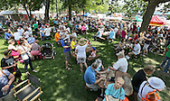 People eat at picnic tables during the 20th Annual Marion Arts Festival at City Square Park in Marion on Saturday, May 19, 2012. (Stephen Mally/Freelance)
