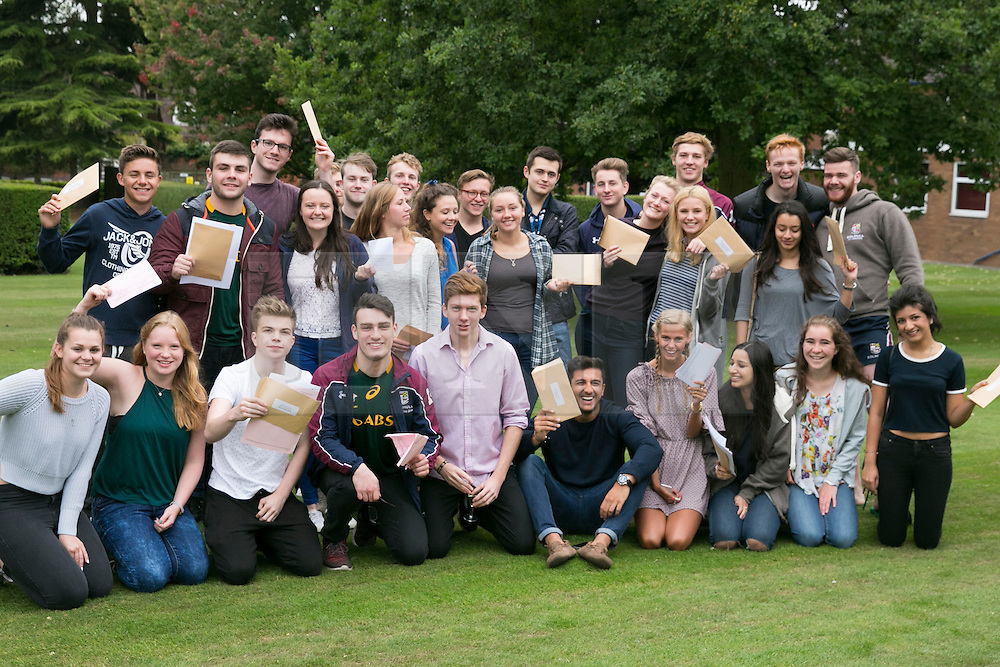 © Licensed to London News Pictures. 13/08/2015. Solihull, West Midlands, UK. A level results day at Solihull School. A record breaking year for the school as it had 88% of students with A Star to B passes. Pictured, A Level students celebrating. Photo credit : Dave Warren/LNP