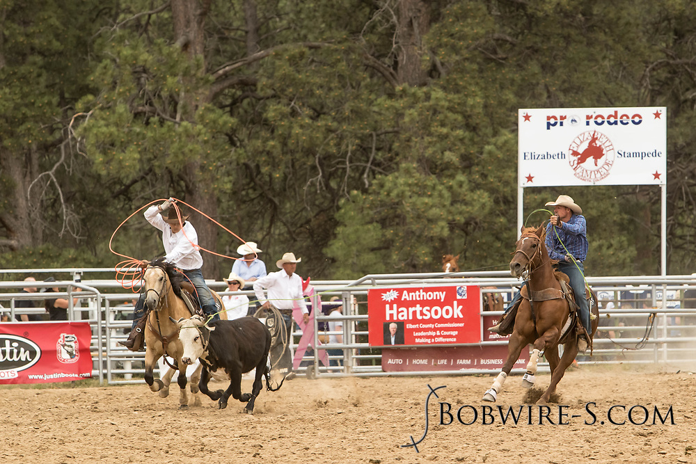 Header Cole Cooper and heeler JC Flake make their team roping run during the third performance of the Elizabeth Stampede on Sunday, June 3, 2018.