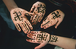 Hands covered with henna tattoos,