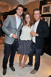 Left to right, OLLIE BAINES from Blake, ANNABEL HARRISON and HUMPHREY BERNEY from Blake at the launch of the Bremont Boutique, 29 South Audley Street, London on 17th July 2012.