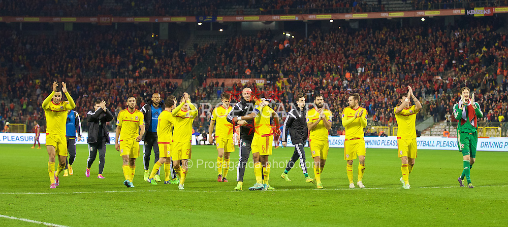 BRUSSELS, BELGIUM - Sunday, November 16, 2014: Wales' Hal Robson-Kanu, Neil Taylor, James Collins, Emyr Huws, captain Ashley Williams, Joe Ledley, Aaron Ramsey and Gareth Bale celebrate a point and staying top of the group after a goal-less draw against Belgium during the UEFA Euro 2016 Qualifying Group B game at the King Baudouin [Heysel] Stadium. (Pic by David Rawcliffe/Propaganda)