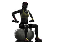 one woman exercising weight training on fitness ball in silhouette on white background