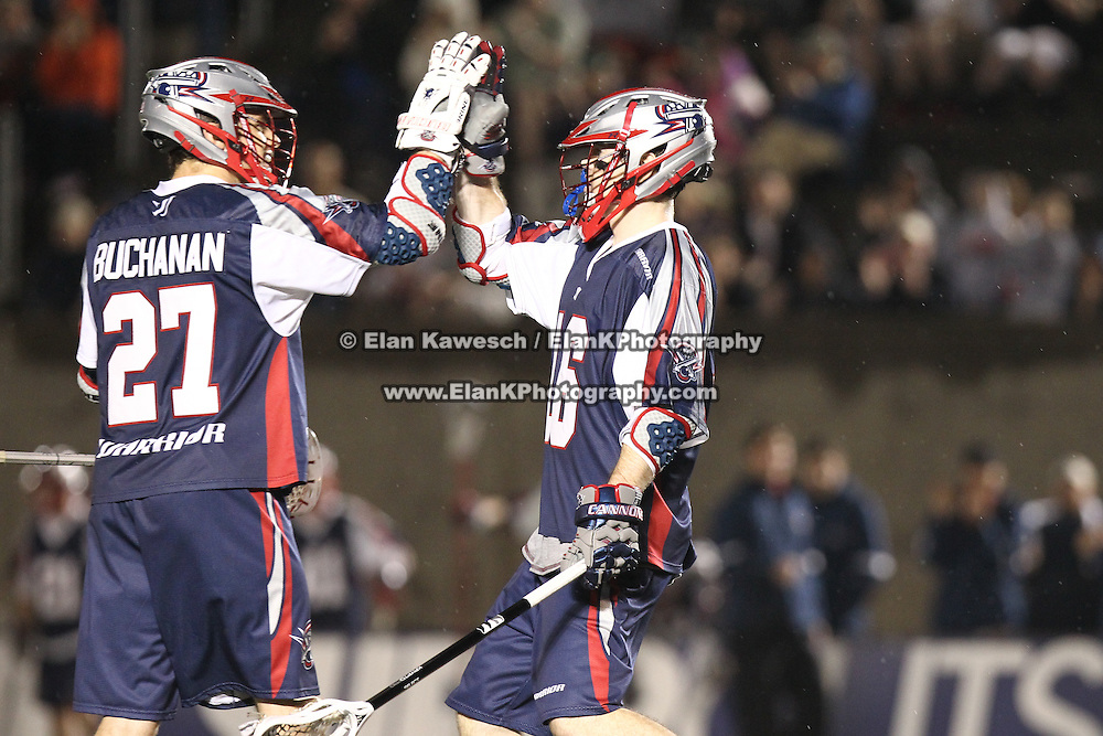 Jack Rice #16 of the Boston Cannons and Kevin Buchanan #27 of the Boston Cannons celebrate a goal during the game at Harvard Stadium on May 10, 2014 in Boston, Massachusetts. (Photo by Elan Kawesch)