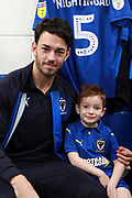 mascot, AFC Wimbledon defender Will Nightingale (5)during the EFL Sky Bet League 1 match between AFC Wimbledon and Blackpool at the Cherry Red Records Stadium, Kingston, England on 29 December 2018.