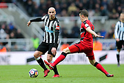 Jonjo Shelvey (#8) of Newcastle United looks up to find a pass as he is put under pressure by Jonathan Hogg (#6) of Huddersfield Town during the Premier League match between Newcastle United and Huddersfield Town at St. James's Park, Newcastle, England on 31 March 2018. Picture by Craig Doyle.