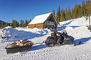 Snowmobiling in winter at Burgdorf Hot Springs near McCall, Idaho.