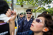 29 NOVEMBER 2013 - BANGKOK, THAILAND: Thai riot police in front of the US Embassy in Bangkok as anti-government protestors march past it. Several thousand Thai anti-government protestors marched on the US Embassy in Bangkok. They blew whistles and asked the US to honor their efforts to unseat the elected government of Yingluck Shinawatra. The anti-government protestors marched through several parts of Bangkok Friday paralyzing traffic but no clashes were reported, even after a group protestors tried to occupy Army headquarters.       PHOTO BY JACK KURTZ
