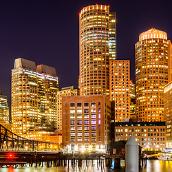 Boston skyline harbor at night panorama picture with downtown Boston skyscrapers and Northern Avenue Bridge. Panorama photo ratio is 1:3.