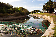 Nets at Marina Da Gama catch plastics in the fresh water Sand River, before it enters Zandvlei, one of 8 estuaries on False Bay, Cape Town.