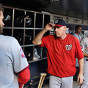 Bryce Harper, (left), Washington Nationals, in the dugout with Matt Williams, Washington Nationals Manager, before the New York Mets Vs Washington Nationals MLB regular season baseball game at Citi Field, Queens, New York. USA. 31st July 2015. Photo Tim Clayton