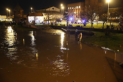 © Licensed to London News Pictures. 13/01/2017. Great Yarmouth, UK. The River Bure reaches high tide in the centre of Great Yarmouth. Environment Agency warnings are in place in some coastal areas ahead of the late night high tides. Photo credit: Peter Macdiarmid/LNP