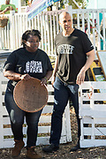 Democratic presidential hopeful Senator Cory Booker, right, chats with Germaine Jenkins, the Chief Farm Officer of the Fresh Future Farm during a visit April 27, 2019 in North Charleston, South Carolina. Booker spent his 50th birthday helping out at the urban farm during his Justice For All tour.