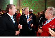 M. Jean Gattuso, président et chef de la direction de A. Lassonde inc. et chef de l'exploitation de Industries Lassonde inc. et Jean Charest, premier ministre du Québec, discutent avec un employé de A. Lassonde inc. lors de l'inauguration de l'entrepôt de A. Lassonde inc...Mr. Jean Gattuso, President and CEO of A. Lassonde Inc. and Chief Operating Officer for Lassonde Industries Inc.,and Mr. Jean Charest, Premier of Quebec with an A. Lassonde Inc. employee during the inauguration of the new warehouse.