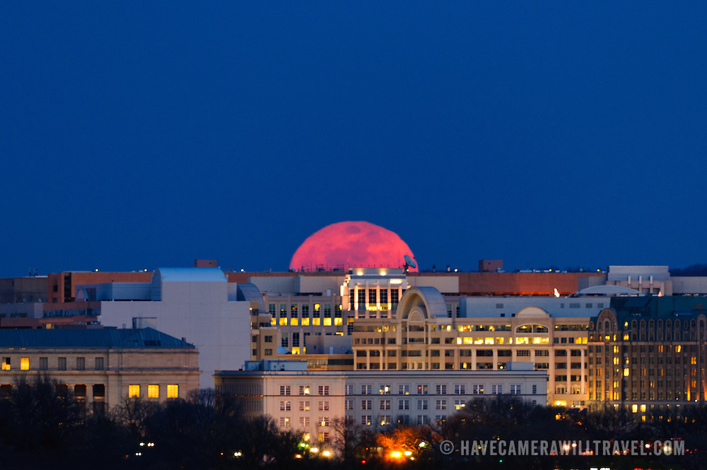 Rising of the so-called Super Moon taken from near the Iwo Jima Memorial in Arlington, VA, looking East over Washington DC. The Supermoon phenomenon occurs when the full moon passes closer to the earth, increasing the size of the moon in the night sky.