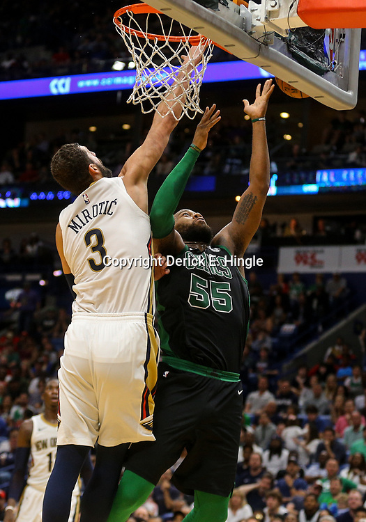 Mar 18, 2018; New Orleans, LA, USA; Boston Celtics center Greg Monroe (55) has his shot blocked by New Orleans Pelicans forward Nikola Mirotic (3) during the second half at the Smoothie King Center. Mandatory Credit: Derick E. Hingle-USA TODAY Sports