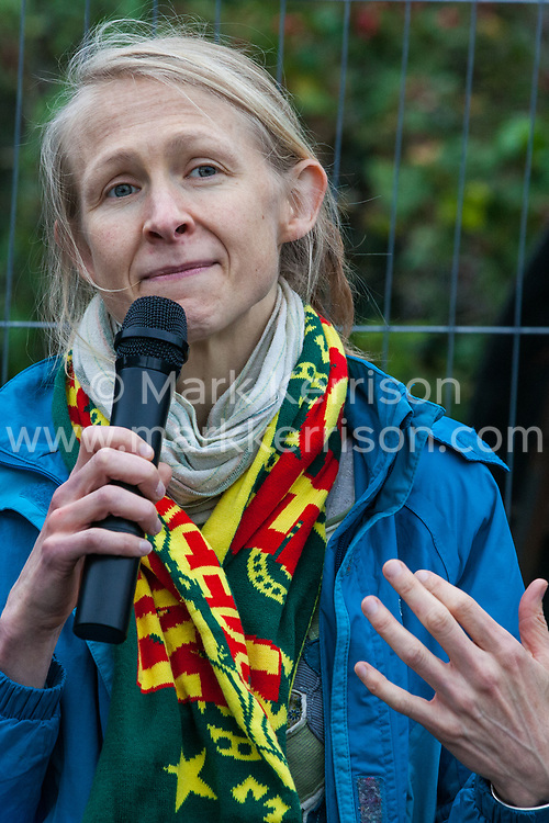 London, UK. 6 September, 2019. A speaker addresses climate activists about Rojava during Stop The Arms Fair protests outside ExCel London on the fifth day of a week-long carnival of resistance against DSEI, the world's largest arms fair. The fifth day of protests was themed as Stop The Arms Fair: Stop Climate Change in order to highlight links between the fossil fuel and arms industries.