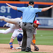 NEW YORK, NEW YORK - July 05: Brandon Nimmo #9 of the New York Mets is called safe at second as Adeiny Hechavarria #3 of the Miami Marlins topples over him during the Miami Marlins Vs New York Mets regular season MLB game at Citi Field on July 04, 2016 in New York City. (Photo by Tim Clayton/Corbis via Getty Images)