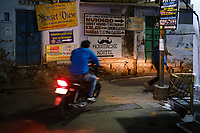 """UDAIPUR, INDIA - CIRCA NOVEMBER 2018: Street of Udaipur at night. The city is the historic capital of the kingdom of Mewar. Surrounded by Aravali Range, which separates it from Thar Desert, and full of lakes Udapiur is also known as the """"City of Lakes"""" and dubbed as the most romantic spot of the Indian Continent."""