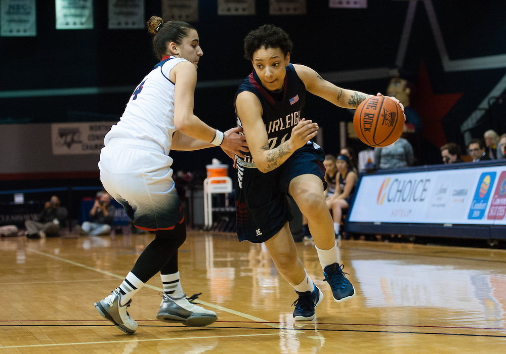 March 6 2016: Fairleigh Dickinson Lady Knights guard Kelsey Cruz (24) drives to the basket past Robert Morris Colonials guard Anna Niki Stamolamprou (4) during the first half in the NCAA Women's Basketball game between the Fairleigh Dickinson Lady Knights and the Robert Morris Colonials at the Charles L. Sewall Center in Moon Township, Pennsylvania (Photo by Justin Berl)