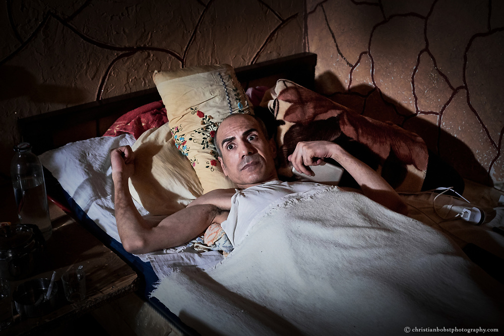 Shatila, Lebanon, April 2017: This Palestinian refugee, who fled to Syria after the Shatila massacre and had to return to Shatila after the outbreak of the Syrian war, has been ill in bed for years. Since his back in Shatila he lies in a dark room without a window. He says his only wish is to leave the camp as soon as possible.