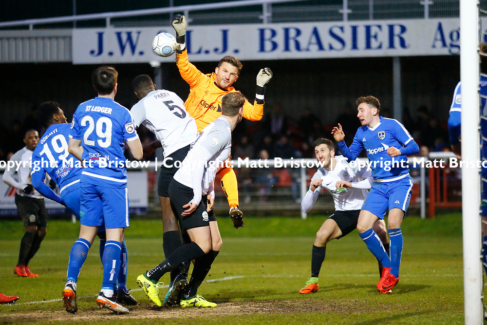 Guiseleys keeper Luke Coddington punches the ball away during the Vanorama National League match between Dover Athletic and Guiseley at Crabble Stadium, London, England on 27 January 2018. Photo by Matt Bristow.