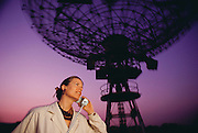 Jill Tarter. Portrait of Jill Tarter (1944-), American astrophysicist and SETI researcher with a princess phone at a radiotelescope at Stanford, CA. Palo Alto, California. (1988)