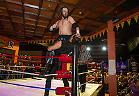 Titas gets the upper hand on Josef Von Schmidt during Pro Wrestling Injustice for Brawl at the Whiskey Barrel Saturday evening.  (Karen Bobotas/for the Laconia Daily Sun)