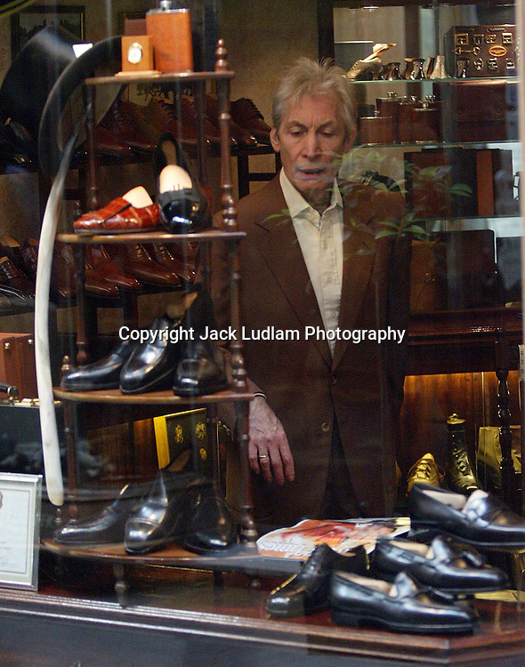 Charlie Watts Surveys The Hand made Steppers in Bond Street Arcade,