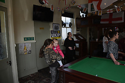 "© London News Pictures. ""Looking for Nigel"". A body of work by photographer Mary Turner, studying UKIP leader Nigel Farage and his followers throughout the 2015 election campaign. PICTURE SHOWS - Members of the public watch while Nigel Farage visits the Wheatsheaf public house, where he toasted the birth of Princess Charlotte of Cambridge, in Ramsgate on May 2nd 2015. The Wheatsheaf was the last of the many pubs in Thanet that Nigel Farage visited on his long campaign. . Photo credit: Mary Turner/LNP **PLEASE CALL TO ARRANGE FEE** **More images available on request**"