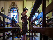 25 MARCH 2016 - BANGKOK, THAILAND: A man prays during Good Friday observances at Santa Cruz Church in Bangkok. Santa Cruz was one of the first Catholic churches established in Bangkok. It was built in the late 1700s by Portuguese soldiers allied with King Taksin the Great in his battles against the Burmese who invaded Thailand (then Siam). There are about 300,000 Catholics in Thailand, in 10 dioceses with 436 parishes. Good Friday marks the day Jesus Christ was crucified by the Romans and is one of the most important days in Catholicism and Christianity.      PHOTO BY JACK KURTZ