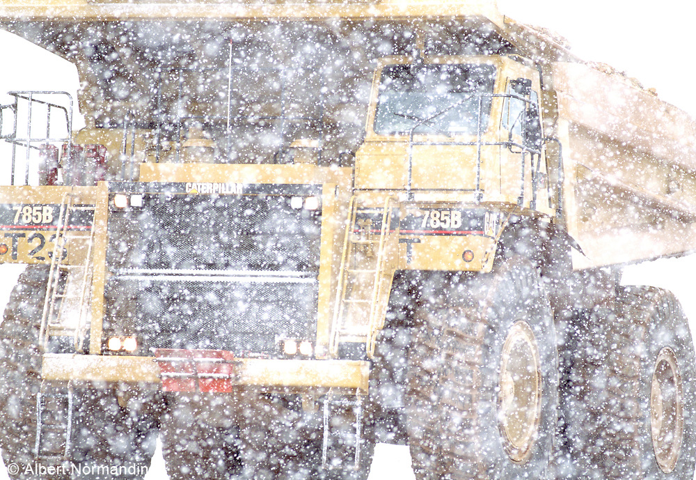 Big yellow CAT truck in snow storm, Black Rock desert