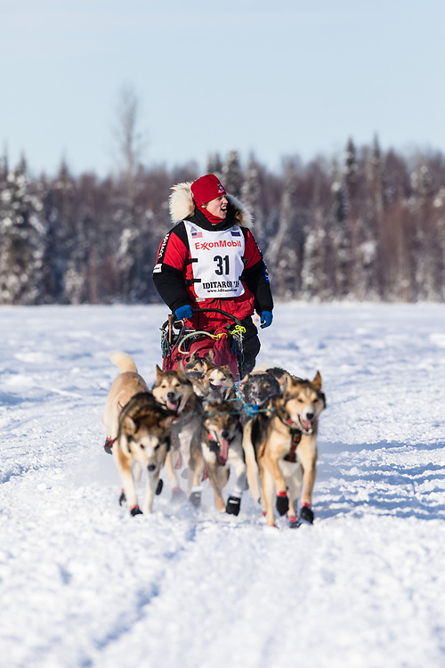 Musher Aliy Zirkle after the restart in Willow of the 46th Iditarod Trail Sled Dog Race in Southcentral Alaska.  Afternoon. Winter.