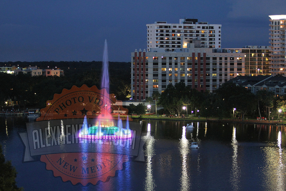 """The lights on the Fountain at Lake Eola park were changed to a rainbow theme, during the """"Marriage Equality Rally"""" at the Lake Eola bandshell in downtown Orlando, Florida on Thursday, June 27, 2013. Orlando's gay community and its supporters are celebrating the U.S. Supreme Court rulings on gay marriage and the Defense of Marriage Act (DOMA) reversal that constitutionally denied legally married gay couples federal benefits. (AP Photo/Alex Menendez)"""