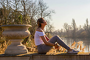 UNITED KINGDOM, London: 26 February 2019. Christina McAlistar, 28 from California enjoys the sunshine in Hyde Park today on what is set to be the warmest day in February since records began. Temperatures are set to reach up to 20 degrees Celsius in the capital today. Rick Findler / Story Picture Agency