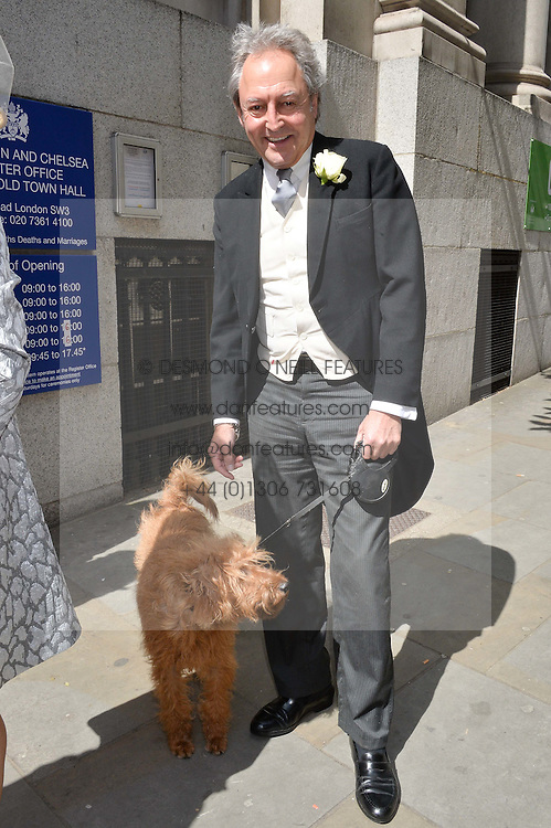 ROD WESTON and his dog Freddie photographed at his wedding at Chelsea Registry Office, Chelsea Old Town Hall, King's Road, London on 30th April 2015.  Pattie Boyd was previously married to both George Harrison and Eric Clapton.
