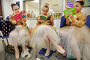 "galmh ""Nutcracker""---From left, Samantha Priddy, Elizabeth Lewis and Hannah Smith enjoy some books while waiting for their turn to hit the stage in Columbia City Ballet's performance of Nutcracker in Clover."