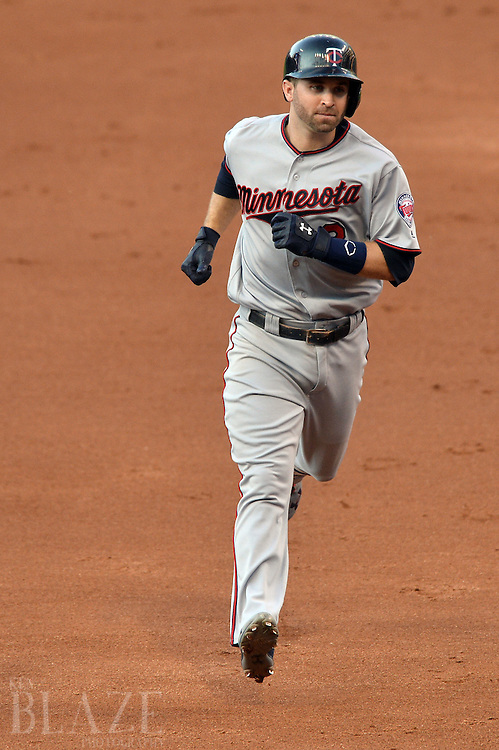 Aug 2, 2016; Cleveland, OH, USA; Minnesota Twins second baseman Brian Dozier (2) rounds the bases after hitting a home run during the third inning against the Cleveland Indians at Progressive Field. Mandatory Credit: Ken Blaze-USA TODAY Sports